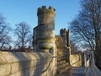 a view along the pedestrian walkway on historic medieval city walls in york showing one of the small defensive towers found at regular intervals on the wall