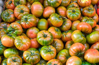 Beef tomatoes for sale at a market