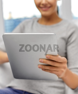 close up of woman with tablet pc computer at home