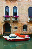Venetian canal with motorboat