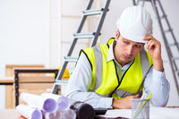 Young male architect working indoors