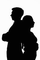 Dark silhouettes of a young couple on a white background