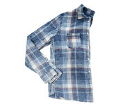Man's cotton plaid shirt isolated on white background, top view Man's blue cotton plaid shirt, folded men's shirt copy space