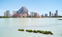 Urban skyline of Calpe. High rise residential buildings against blue sky background. Salt lake water view. Sunny summer day, no people. Province of Alicante, Costa Blanca, Spain