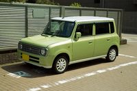 A Square Green car Parked in a Parking