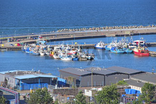 Many boats are moored on pier on Baltic sea. Modern water transport