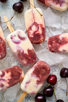 Delicious, homemade popsicles made from cherries and cream.