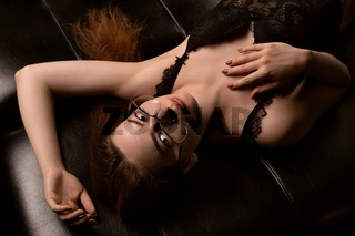 Sensual young woman in lingerie and eyeglasses
