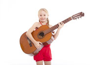 young happy girl standing with guitar