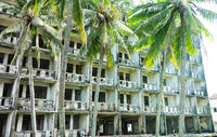 Abandoned hotel in coastal recreation area in Southeast Asia.