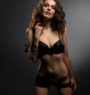Sexy tattooed brunnette in underwear posing