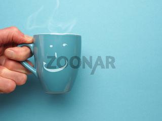 Blue coffee mug with a smiling icon