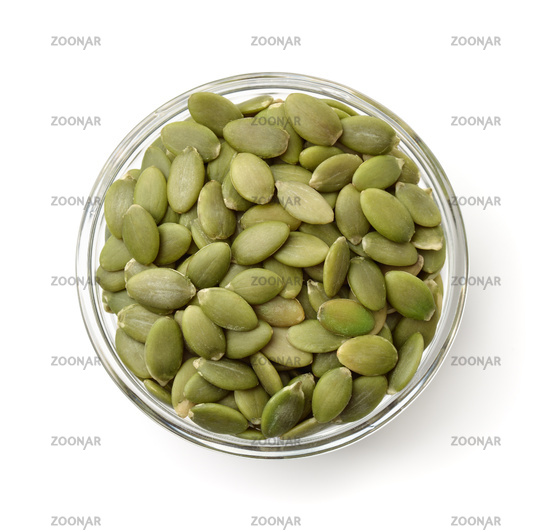 Top view of pumpkin seeds in glass bowl