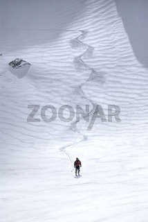 Astonishing view of a skier at the foot of a ski slope