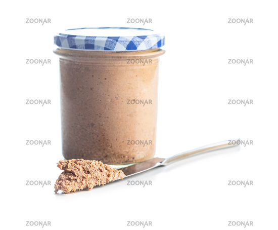 Liver pate in jar isolated on white background.