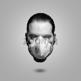 Elevated head of a man wearing a FFP3 respiratory mask. Corona virus sickness and burnout symbol concept.