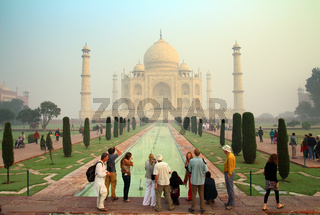 tourists in Taj Mahal - famous mausoleum in India