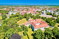 Town of Cakovec rooftops and green park aerial view