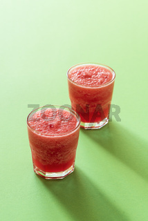 Glass of watermelon drink. Two portions of slush. Cold beverage