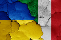 flags of Ukraine and Italy painted on cracked wall