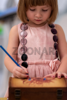 little girl painting jewelry box