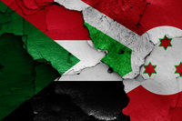 flags of Sudan and Burundi painted on cracked wall