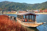 Boat and Kintai Bridge over Nishiki river in Iwakuni