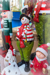 snowman in red scarf at the christmas market