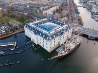 Amsterdam, North-Holland, The Netherlands - 12-25-2020 Amsterdam center, Aerial view the Scheepvaartmuseum and the historic boat martime history