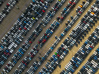 Aerial shot of parked cars in a structured row parking lease cars new production industry