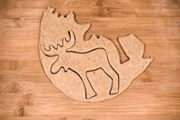 Top view of reindeer shaped gingerbread dough