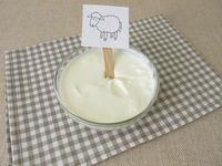 Fresh sheep quark, farmer cheese from the sheep in a glass bowl