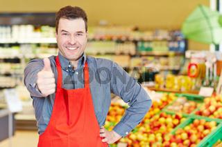 Verkäufer gratuliert mit Daumen hoch