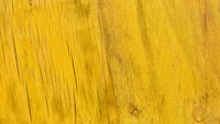 Maserung von gelbem Holz als Hintergrund Textur