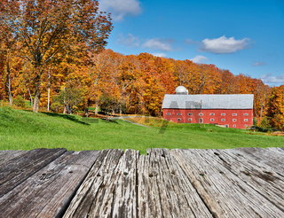 Farm near highway at autumn day, Vermont, USA.