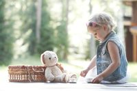 Girl playing with teddy bear