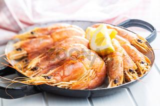 Boiled tiger prawns on pan. Tasty shrimps.