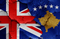 flags of UK and Kosovo painted on cracked wall
