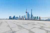 shanghai skyline and empty granite stones ground
