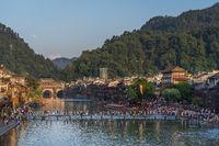 People crossing river in Fenghuang