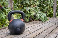 iron kettlebell on wooden deck