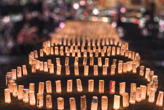 Handmade japanese washi paper lanterns aligned in circles illuminating the ground of the Zojoji temp