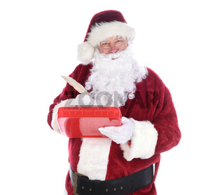 Santa Claus holding a clipboard holding aqill pen making notes on his naughty and nice list. isolated on white.