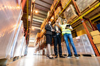 Manager show warehouse inventory to business man owner.