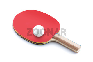 Ping pong ball resting on a table tennis bat paddle on white