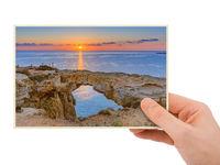 Hand and Famous stone Sin Bridge at sunrise in Ayia Napa Cyprus (my photo)