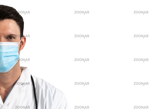Portrait of male doctor wearing face mask against white background