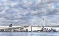 Circular highway leading to the Rainbow Bridge of Odaiba bay in Tokyo.