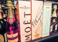 Bottled alcoholic beverages champagne ready for sale on the shelves in supermarket