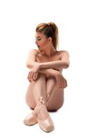 Naked young ballet dancer in pointe shoes